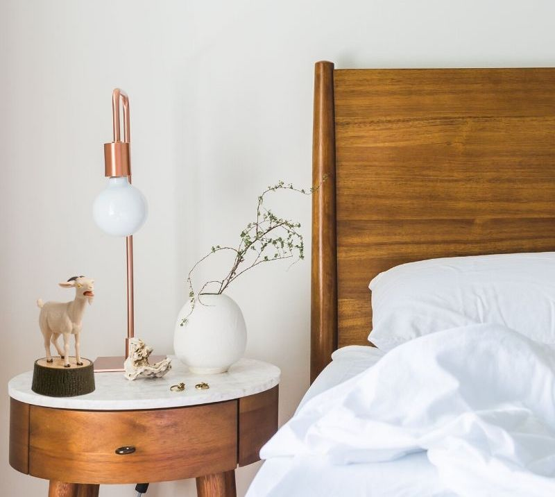 yelling goat statue next to bed