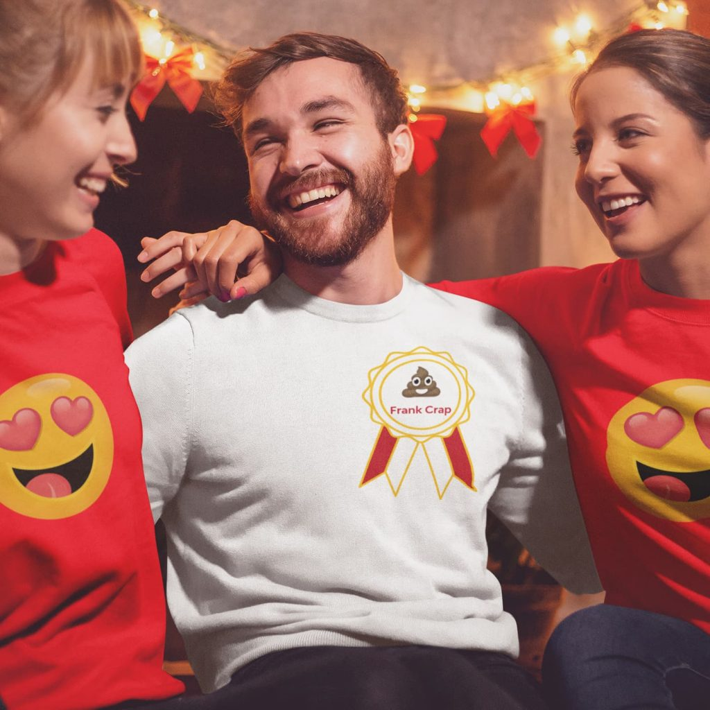 Young man, Frank Crap with a shirt with a poop emoji on it, with two young women who have heart eye emojis on their shirts.