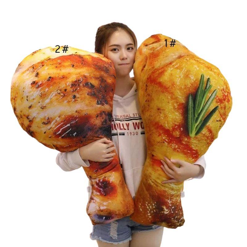 girl holding friend chicken pillows