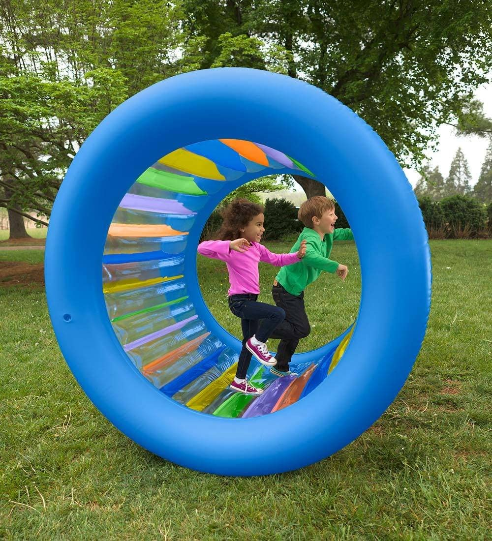 kids playing on an inflatable hamster wheel