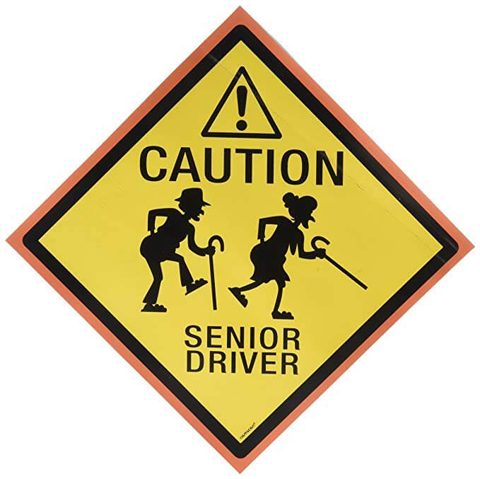 Caution: senior driver sticker with two seniors with canes